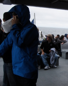 Using a puke bag on Boston Harbour Whale Tour
