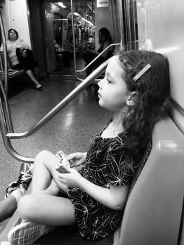 She make look bored but she loves a good subway ride.